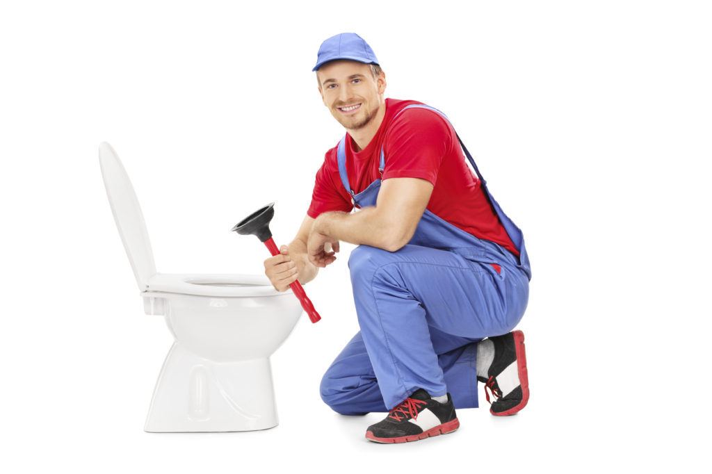 Male Plumber Sitting Next To A Toilet And Holding A Plunger